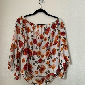 orange and pink flowy, off the shoulder blouse